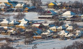 Winter village, houses in the snow. stock photo