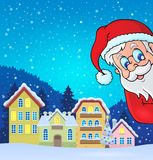 Winter village with lurking Santa Claus Stock Photo