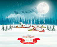 Winter village night Christmas background. Stock Photo