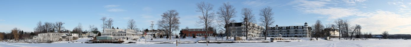 Winter Village Panorama. Winter panorama of the village of Bemus Point, NY as seen from the frozen surface of Chautauqua Lake.  Visible from left to right are Stock Photo