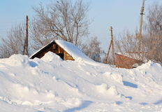 Winter in the village. In the winter in the village put to snow above a roof Stock Photo
