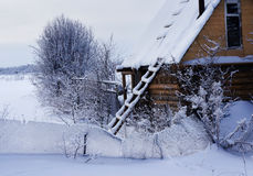 Winter village, snowy evening Royalty Free Stock Photos