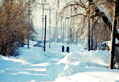 In the winter in the village. Of the street brought white snow Stock Photography