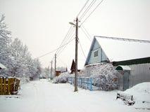 Winter village street Stock Images