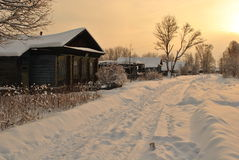 Winter in the village, sunny morning Stock Photos