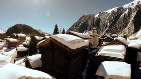 Winter village tourism snow covered houses snow winter landscape aerial view stock video