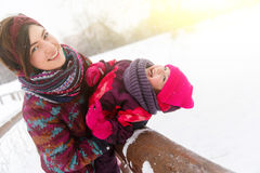 Winter walk woman with daughter Royalty Free Stock Photography