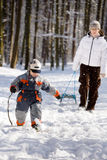 Winter walk in the woods. Mom with his son on a walk in the woods in winter Royalty Free Stock Photo
