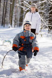 Winter walk in the woods. Mom with his son on a walk in the woods in winter Royalty Free Stock Photos