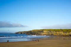 Winter walkers on Ballybunion beach Royalty Free Stock Photo