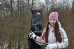 Winter walks with horse Stock Photography