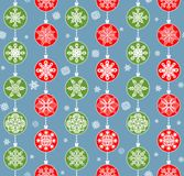 Winter wallpaper with hanging red and green snowflakes Stock Photos