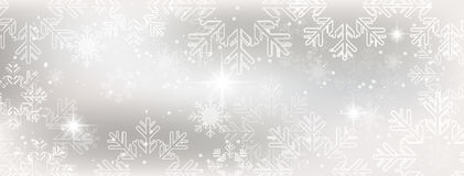 Winter wallpaper with snow, snowflakes and glowing stars. Stock Image