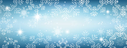Winter wallpaper with snow, snowflakes and glowing stars. Stock Photography