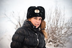 Winter of the war. Girl winter in the military hat Royalty Free Stock Image