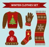 Winter warm clothes icon set, flat style. Christmas clothing,apparel collection with patterns. Hat, scarf, gloves Stock Photos