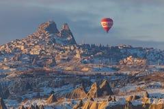 Winter warm dawn with red balloon on hotfire balloons festival, cappadocia, turkey, kappadokya Royalty Free Stock Image