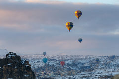 Winter warm dawn with red balloon on hotfire balloons festival, cappadocia, turkey, kappadokya Stock Images