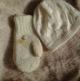 Winter warm knitted hat and mittens. Mobile photo with white mittens, hat and herbs stock photos