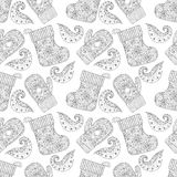 Winter warm knitted mittens, socks seamless pattern in zentangle Royalty Free Stock Photos