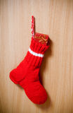 Winter warm sock with christmas gift on wooden background Stock Images