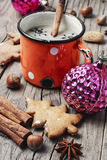 Winter warming cappuccino. Homemade Christmas cookies with spices, and coffee with milk royalty free stock image
