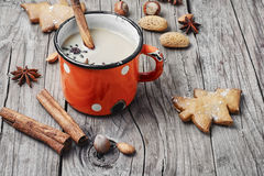 Winter warming cappuccino. Homemade Christmas cookies with spices, and coffee with milk royalty free stock photos
