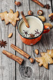 Winter warming cappuccino. Homemade Christmas cookies with spices, and coffee with milk royalty free stock photo