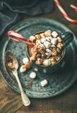 Christmas hot chocolate with marshmallows and candy cane stock image