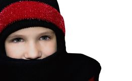 Winter Warmth. Girl in winter clothing on white background Royalty Free Stock Image