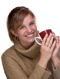 Winter Warmth. Young Woman With Pony Tail Holding A Mug Of Drinking Chocolate stock photography