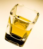 Winter warmth. A glass of whiskey shot on my lightbox Royalty Free Stock Images