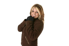 Winter Warmth. Female wearing her winter coat and gloves trying to keep warm royalty free stock image