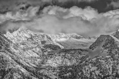 Winter on the Wasatch BW. Snow covers the Wasatch mountains in January 2014 with clouds hanging over them low. shot taken from the Salt Lake city Valley in Utah Royalty Free Stock Photography