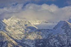 Winter on the Wasatch. Snow covers the Wasatch mountains in January 2014 with clouds hanging over them low. shot taken from the Salt Lake city Valley in Utah USA Royalty Free Stock Image