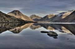 Winter in Wasdale. Reflections of the mountains of Wasdale in Wast Water on a calm winter day.  English Lake District Stock Photo