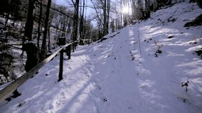 Winter waterfall. Carpathians Ukraine. Active rest on a winter sunny day. stock video