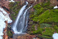 Winter Waterfall and Melting Snow Stock Photo