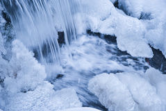 Winter waterfall. Mountain stream waterfall with icicles in wintertime Stock Photo