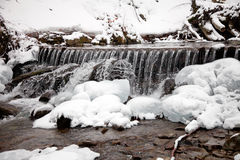 Winter waterfall in the snowy forest Stock Photo