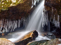 Winter waterfall thaw and icicles Royalty Free Stock Images