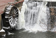 Winter Waterwheel and Waterfall Stock Photo