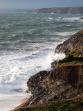 Cornwall Coast Winter Waves. Winter waves along the south west coast of Cornwall looking from Loe Bar towards Porthleven and Penzance and Newlyn beyond Stock Photo
