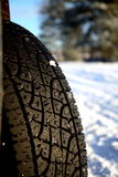 Winter way. Car tire in the winter way stock photos