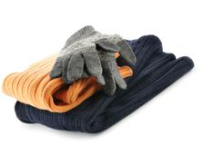 Winter wear. Two sweaters and gloves isolated over white background stock photo