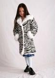 Winter wear. Young girl wearing an animal-print winter coat Stock Image