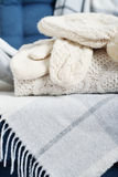 Winter Wear. Stack of winter wear and accessorize closeup on couch Stock Photos