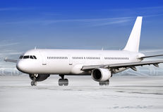Winter weather. Airport and white plane at winter weather Stock Photos
