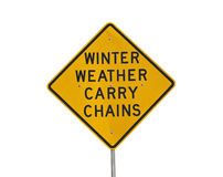Winter Weather Carry Chains. Warning sign isolated on white stock photography