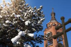 Winter  weather church. Sunny winter n weather in village Royalty Free Stock Photos